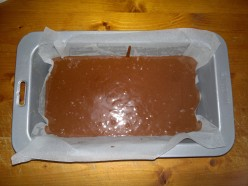 Pour the mix into the prepared cake tin.
