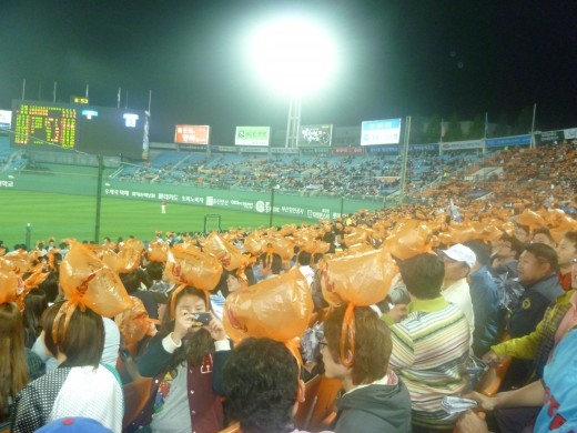 At a Busan Giants baseball game.  Towards the end of the night orange garbage bags are handed out and everyone sports them on their heads.