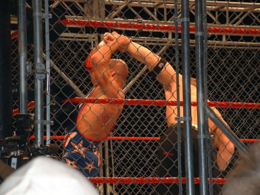 Kurt Angle and John Cena face off in a steel cage match at a WWE house show in the MEN Arena in Manchester, United Kingdom on 17 November, 2005.