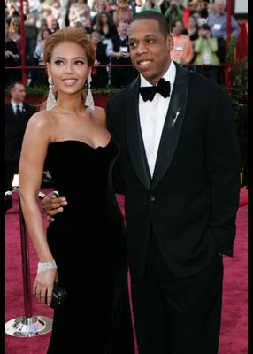 Beyonce and Jay-z posing for the camera as equal partners.