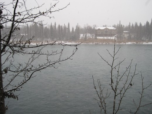 The color of a river freezing over, the color of snow moving in.