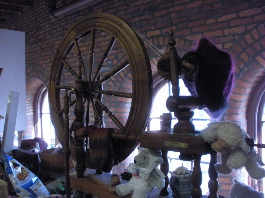 A spinning wheel on display at the Cultural Arts Center.