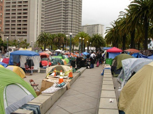 View of Occupy San Francisco, facing North. I'm standing on the pony wall, just above the black plastic homeless tent and the mustard yellow blanketed man.