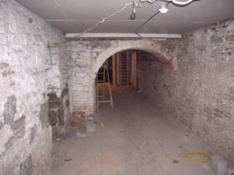 Renovate a basement to include the proper ceiling height according to local building codes.
