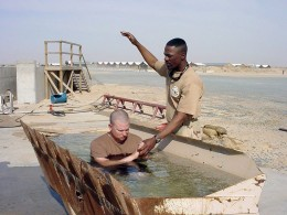US Navy chaplain administers baptism in Iraq. Definitely not salvation by works, but doing nothing is a sin, and that does not lead to salvation.