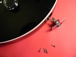Once you have undone all of the screws, gently pull the socket plate away from the guitar.... carefully, as there may not be much lead!
