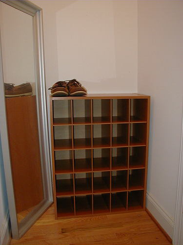 Many shoes can be stored in this type of rack.