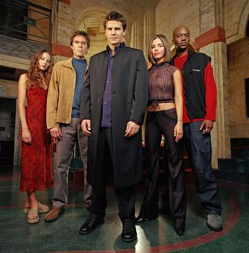 "Boreanaz is flanked by his PI associates who dealt with the supernatural on ""Angel."""