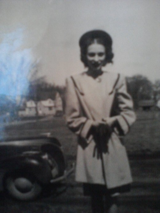 Mom at a very young age in Elma, Iowa at her home when she lived with her mother and father. Mom when she was a young girl at her parent's home in Elma, Iowa.
