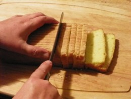 The layers begin with slices of sugar cake