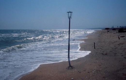sandy beach on Caspian Sea in Dagestan. Why is there a street lamp on the shore?