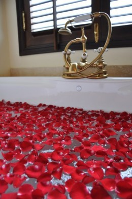 A lavish bath with rose petals
