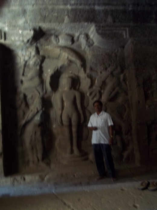 Lord Parshwanatha statue,present in the 31st cave,Ellora(Author is seen)