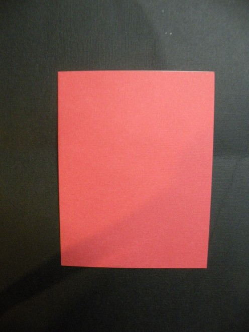 "Red cardstock cut and folded to be a 5 1/2 x 4 1/4"" card"