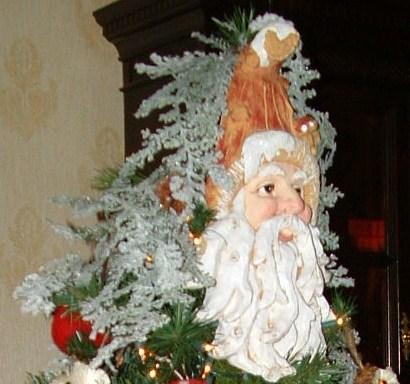 Top of Santa themed tree.