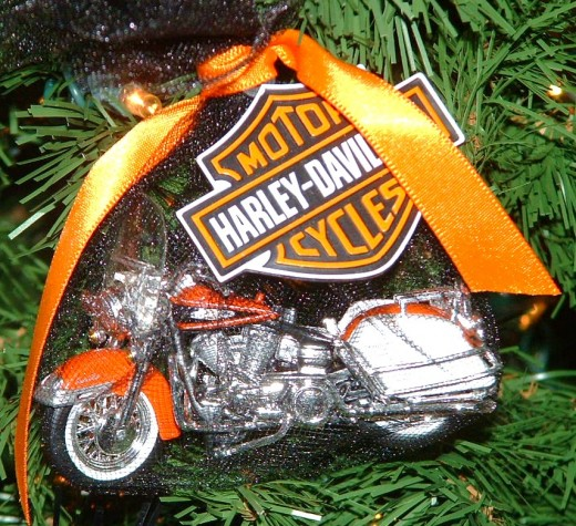 Other Harley Davidson models are wrapped in black netting tied with orange bows.