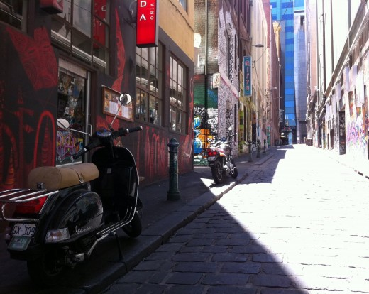 The entrance to Hoiser Lane, looking from Flinders street. The premise next to where the little black scooter is parked is actually a quaint restaurant and cafe
