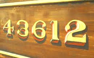 Close-up of LNER teak panelling with gold-sized numbering