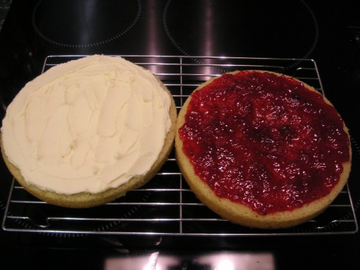 Cover One Half With Jam, The Other With Butter Cream And Sandwich Together.