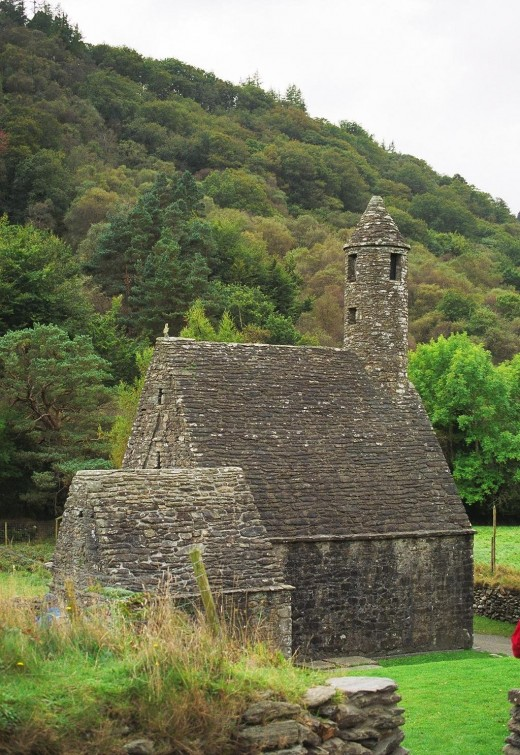 "St. Kevin's Kitchen (church) at Glendalough - the round tower on the church stands 46 feet high. This is considered an ""engaged"" tower, as it is connected to the church building."