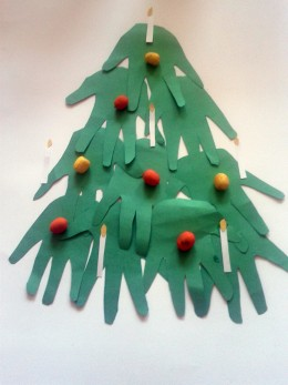 """Ten green paper """"hands in ascending order. Add painted acorn """"fruit"""" and white paper candles with a yellow paper """"flame""""."""
