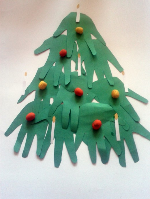 "Ten green paper ""hands in ascending order. Add painted acorn ""fruit"" and white paper candles with a yellow paper ""flame""."