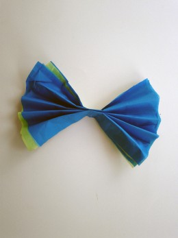 Fold different colors together accordion style and staple in the middle
