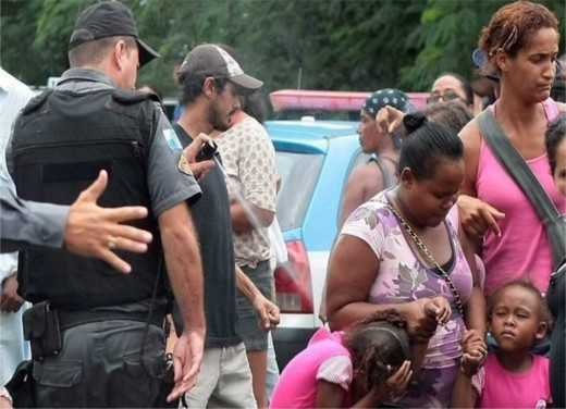 Brazilian cop photographed pepper spraying a small child.