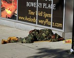 A Bowery 'street sleeper,' finds rest on the concrete mattress of the city when there is no room in the mission.