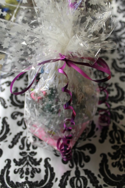Coffee Mug Gift Basket wrapped in semi-transparent plastic gift wrap.