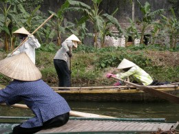 Vietnamese women at work equipped with the traditional Vietnamese conical hat. Tam Coc, Vietnam.
