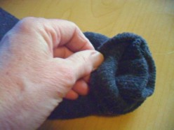Two socks are used to make this plush dog toy by placing one sock inside the other it makes the head and body thicker.