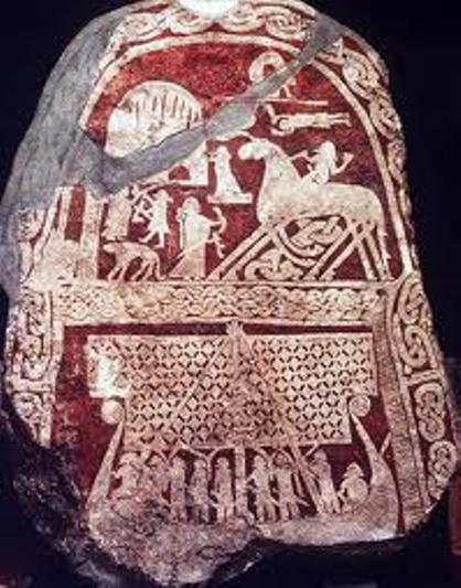 Memorial stone on Gotland depicts in the top half Odin on his eight-legged steed Sleipnir in Asgard; the bottom half shows a crew on their ship - note the detail on the sail