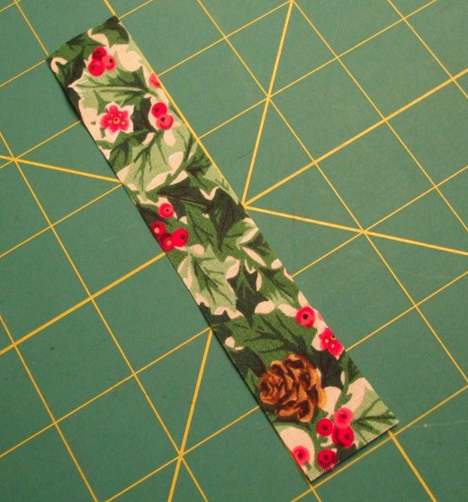 Use a scrap of fabric about 1 x 6 inches large.