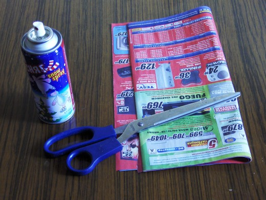 Artificial snow, scissors, old paper ADs.