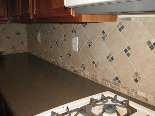 A tumbled stone backsplash adds character and dimension to a kitchen's design.