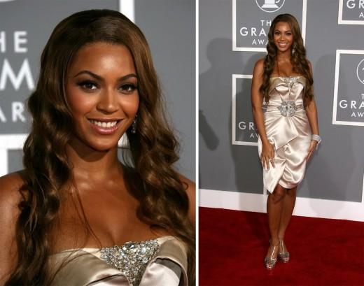Beyonce big curl hairstyle.