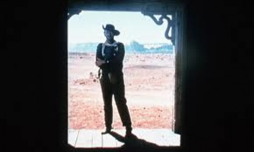 John Ford's amazing framing - John Wayne with Monument Valley in the distance.