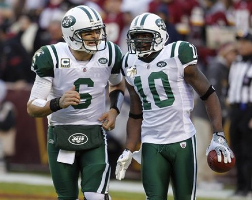 New York Jets wide receiver Santonio Holmes, right, runs off the field with quarterback Mark Sanchez after scoring a touchdown on a pass from Sanchez during the second half of an NFL football game against the Washington Redsk insin Landover, Md., Sun