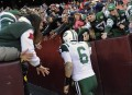 New York Jets quarterback Mark Sanchez is congratulated by fans as he leaves the (AP Photo/Nick Wass)