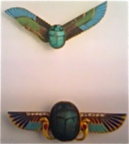 Art Deco scarab brooches