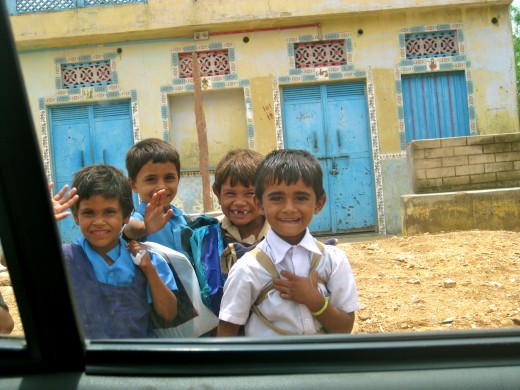 Adorable kids who were waving to us as we were approaching Pushkar