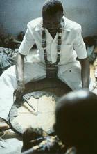 Babalawo Kolawole Ositola at work with his Ifa tray.