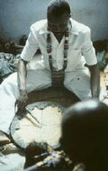 Babalawo Kolawole Ositola at work with his Ifa tray.