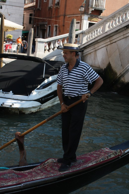 A Gondileer (the person that rows the gondola).