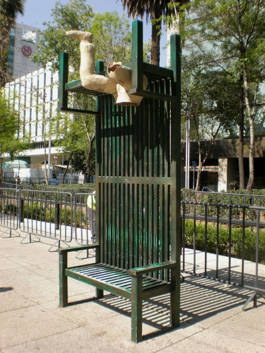 Street Art Exhibit I: Vertical Up & Down Bench with Leg. Visit Mexico and Interact with its Urban Furniture.