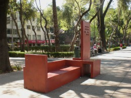 Street Art Exhibit F: Asymmetrical Red Bench. Visit Mexico and Interact with its Urban Furniture.