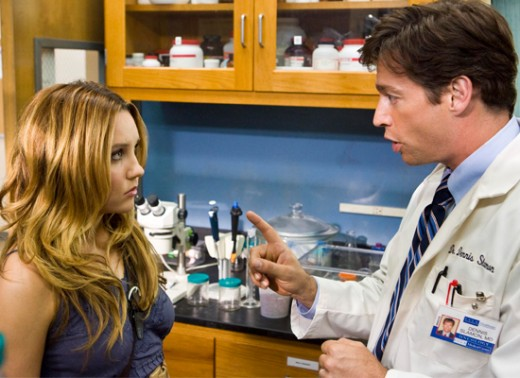 "Harry Connick Jr. teaches the finer points of his research to Amanda Bynes in ""Living Proof."""