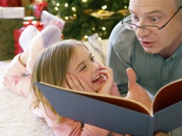 The best of all gifts around any Christmas tree is the presence of a happy family all wrapped up in each other. - Burton Hillis