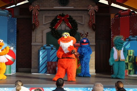 Sesame Street's Murry in holiday gear for the show